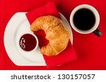 fresh croissant with marmalade and coffee - stock photo