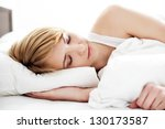 Portrait of young woman sleeping in the bed - stock photo