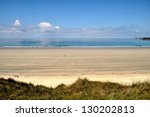 Long sandy beach in the Bretagne in France - stock photo