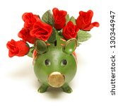 A pig bank and red roses represent the love of money. - stock photo