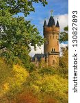 POTSDAM, GERMANY - OCTOBER 22: The Flatowturm Tower in Babelsberg park was built between 1853 and 1856 with stones from the former princely estate in Flatow (Western Prussia). - stock photo
