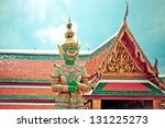 BANGKOK, THAILAND - AUGUST 11: guardian statue in Grand Palace, Bangkok - Thailand on August 11,2012. Buddhism is Thailand official religion and is the religion of more than 90% of its people - stock photo