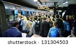 STOCKHOLM, SWEDEN - AUGUST 30 Subway train passengers crowding to get on and off subway station platform T-centralen, the hub of the Stockholm SL transportation system in Stockholm on August 30, 2012. - stock photo