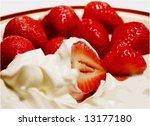 Strawberries and sweet cream - stock photo