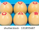Eggs drawn with geometric shapes - stock photo