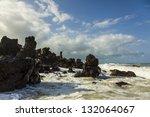 waves smashing on rocks at the beach. Brazilian Beach. - stock photo