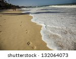 Footprints in the sand of a  Brazilian beach. - stock photo