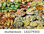 A large collection of colorful clay pottery souvenirs for sale - stock photo