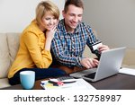 Young couple paying with credit card for online shopping - stock photo
