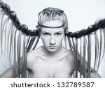 Portrait of beautiful young woman with creative braid hairdo - stock photo