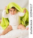 Cute Baby With Green Towel On Head - stock photo