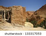 Chebica oasis in Tunisias - ruins of old place - stock photo