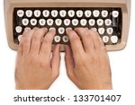Hands on a typewriter keyboard with a white background - stock photo