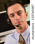 Closeup of a Caucasian Male Receptionist with Headset - stock photo