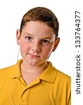 Young boy listening to mp3 player - stock photo