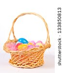Easter basket with colorful eggs - stock photo