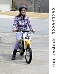 A young girl on a motorcycle. - stock photo