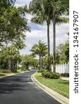 Road to community buildings in Naples, South Florida - stock photo