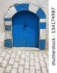 Blue door in Tunisia - stock photo