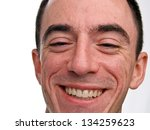 Caucasian Male Headshot laughing - Extreme Closeup - stock photo