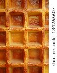 Waffel texsture background taken from a big waffel. - stock photo