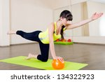 Pretty young girl fitness workout with little ball - stock photo