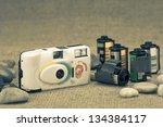 Retro film camera and film cartridge - stock photo