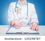 Woman doctor threw up pills on blue background - stock photo
