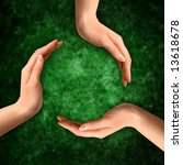 Conceptual recycling symbol made from hands on abstract grungy green background - stock photo