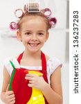 Little girl with cleaning utensils and a big grin - stock photo