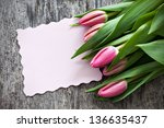 tulips and paper with copy space - stock photo