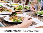 Party food on beautifully set table, healthy salad and tart for lunch garden party - stock photo