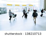 picture of traveling people in motion blur at the airport - stock photo
