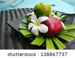 plate with fresh mixed fruits - stock photo