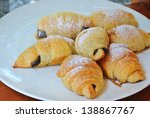 Fresh and tasty croissant on white Plate - stock photo