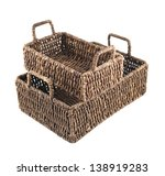 Composition of two brown wicker baskets, box shaped, isolated over white background - stock photo