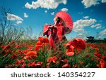 Woman in red clothes with chinese umbrella in the poppy field - stock photo
