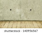 Concrete crack wall and light hardwood floor - stock photo