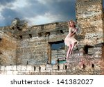 Fantasy style portrait of the strange woman in the ruins - stock photo