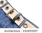 Frame. Jeans and belt. A half frame is located a white background. - stock photo