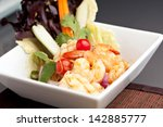 Thai Seafood Salad - Thailand style seafood salad with clear vermicelli style rice noodles and veggies. - stock photo