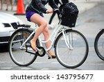 Woman profile biking in traffic - stock photo