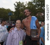 NEW YORK - JUNE 26: Joakim Noah as MVP accepts wrist watch from Girard-Perregaux at The Sixth Steve Nash Foundation Showdown at Sarah D. Roosevelt Park on June 26, 2013 in New York City. - stock photo
