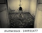 Horror scene of a scary woman in the dark room - stock photo