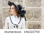 Old-fashioned dressed woman with wandering gaze - stock photo