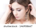 Elegant woman portrait close-up looking down - stock photo