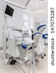 Vertical photo of a dental seat with equipment - stock photo