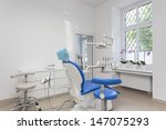 Bright interior of dentist room and seat - stock photo