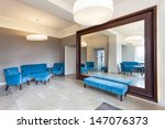 Huge mirror with frame nad colorful furniture - stock photo