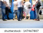 Passengers about to enter train, motion blur - stock photo
